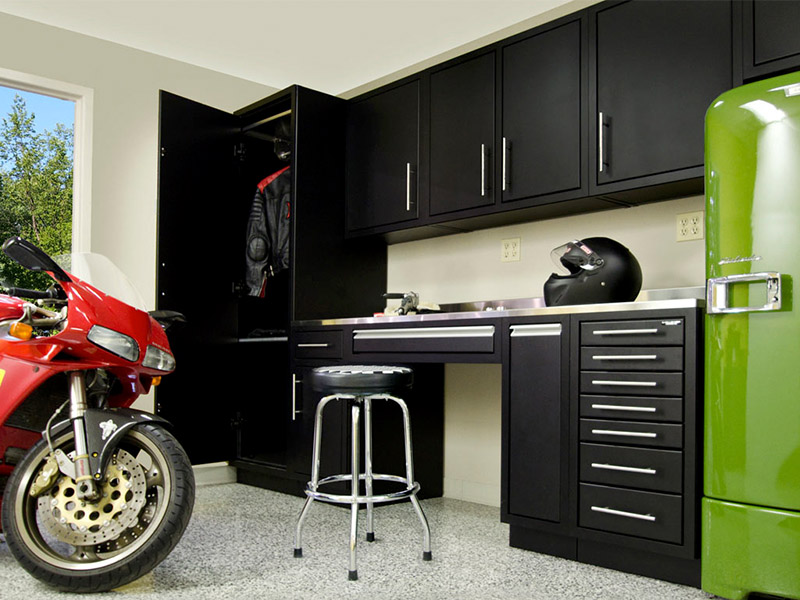 garage with organized tool storage and motorcycle
