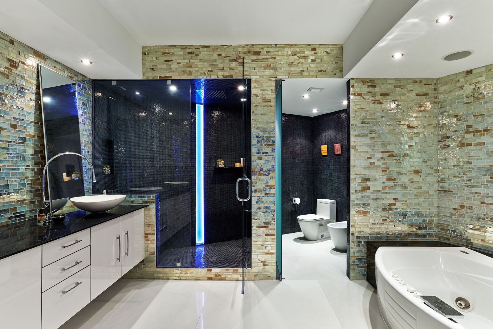 Mater bathroom with Metropolis Opal Mosaic Tile Walls by Granite Transformations/Trend.