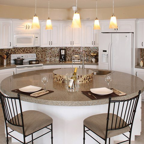 Bianco Modena Granite Countertops paired with Evolution Mosaic Tiles