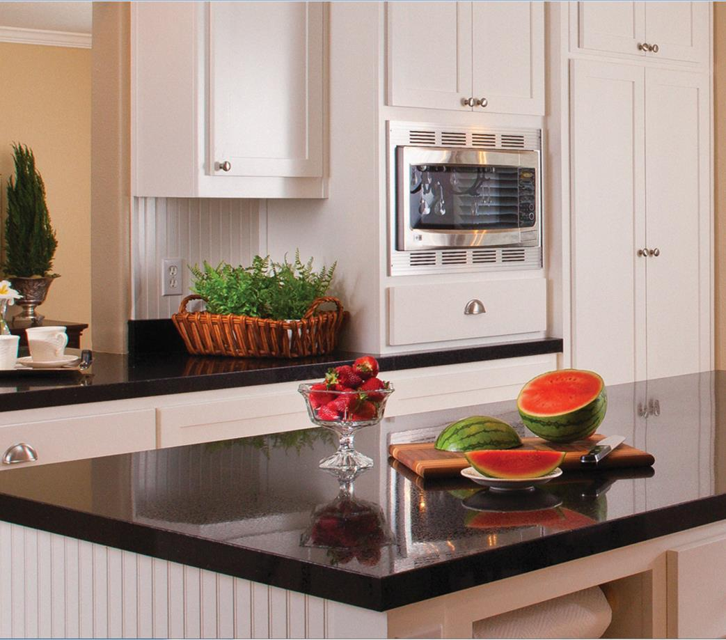 Contrasting black countertops with white cabinets are complementary in kitchen design.