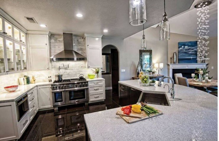 Kitchen with white counters and cabinets and dark floors