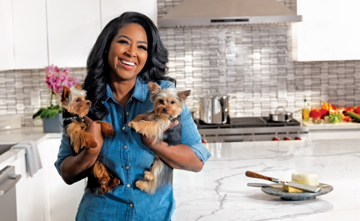 Kenya enjoying her new kitchen with her dogs