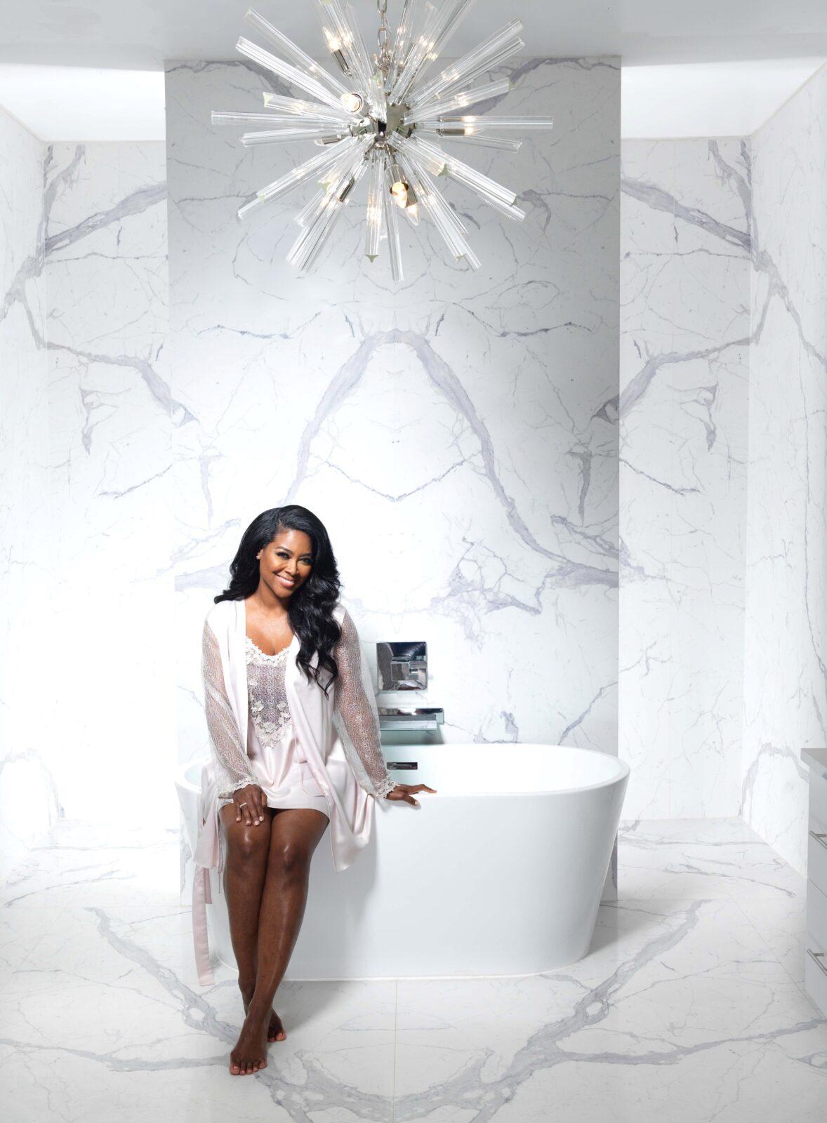 Kenya Moore's master bathroom clad in Statuario by TREND Transformations/Granite Transformations