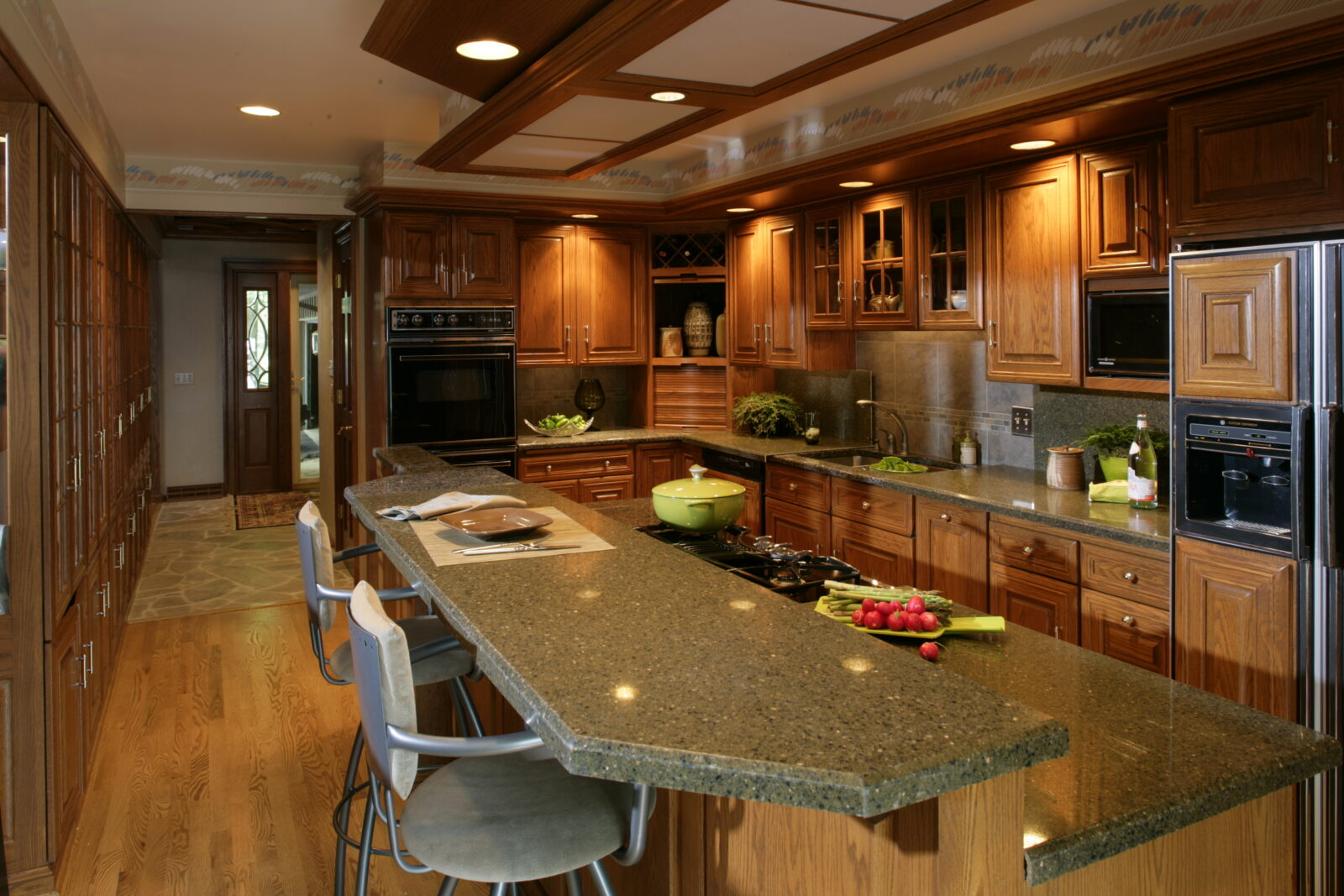 Remodeled kitchen featuring granite countertops by Granite Transformations