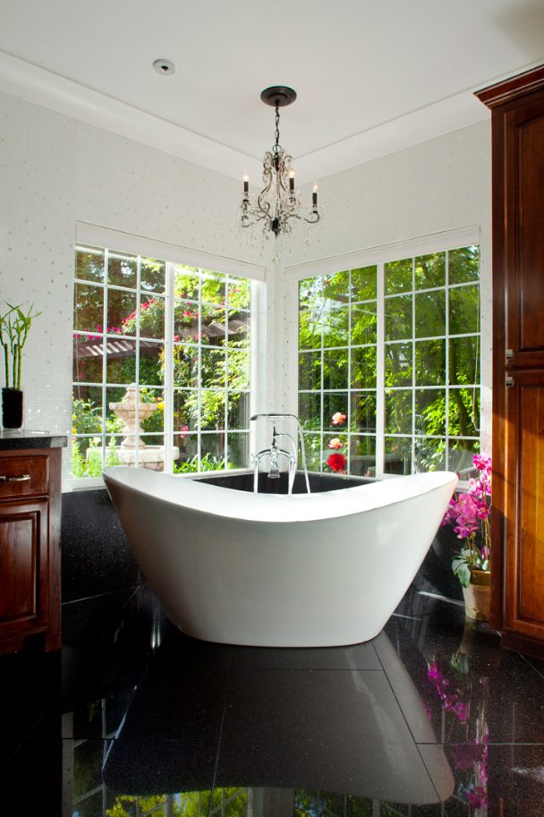 Free-standing tubs will become the norm in 2015 over glass-encased showers and tubs.