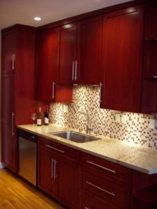Rich cherry wood cabinets.