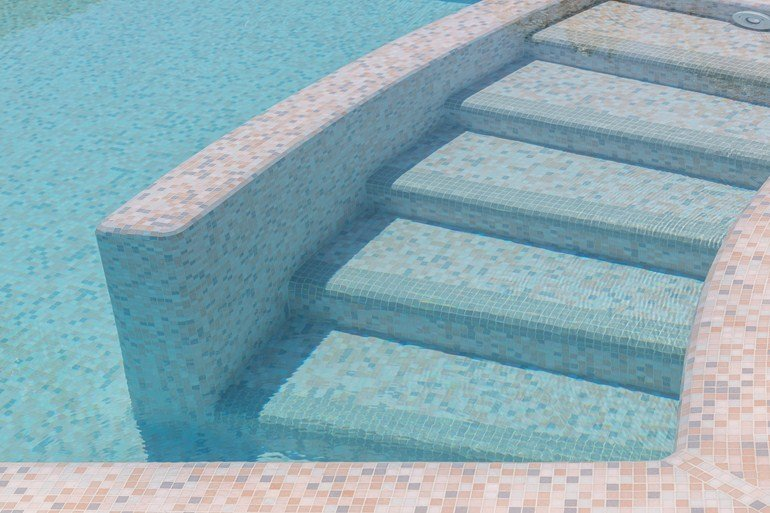 Glass mosaic tile stairs in pool