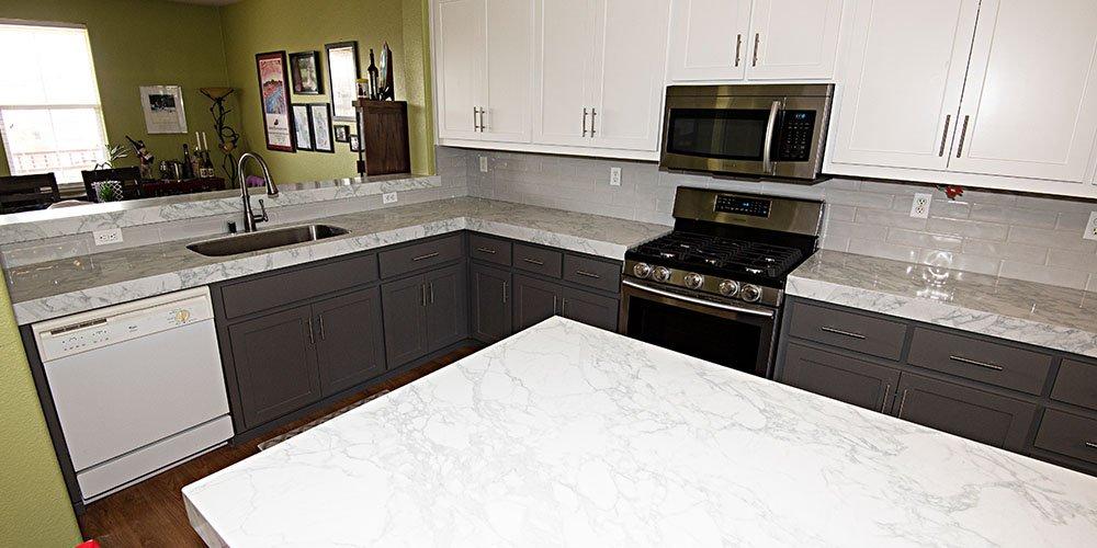 modern kitchen design with white countertops and white backsplash