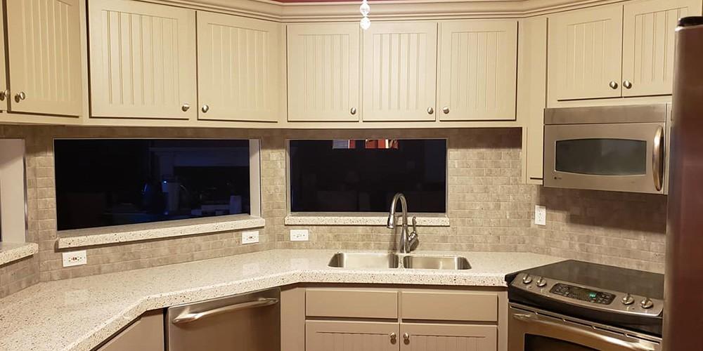 modern kitchen remodel with white copper quartz countertops