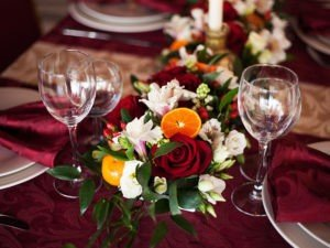 GT Thanksgiving on burgundy table cloth and flowers