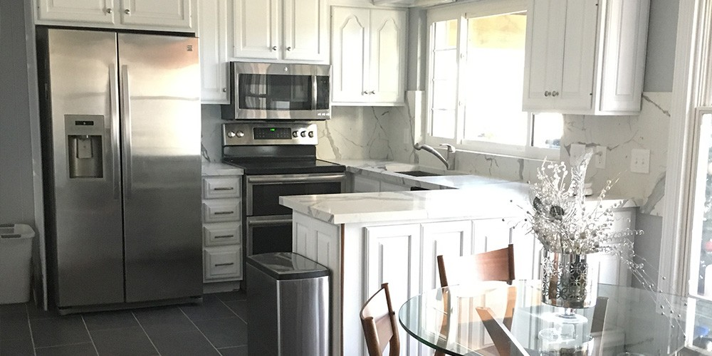 Updated kitchen countertops and high backsplash