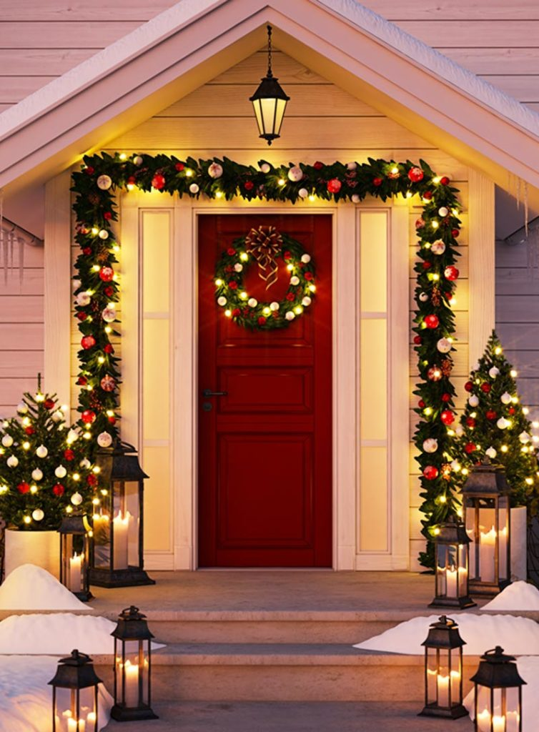 Front door of home decorated for Christmas