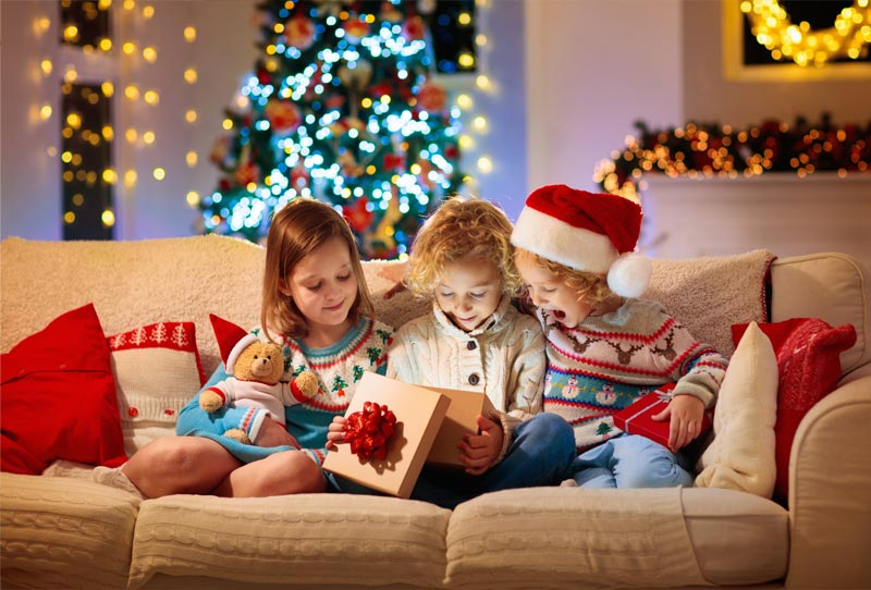3 children opening a Christmas gift