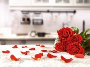 GT Red Roses and rose pedals on kitchen counter