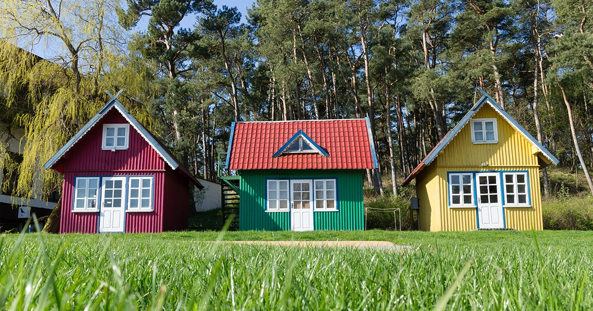GT Three Tiny Houses in Field