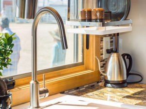 GT Kitchen Counter with Faucet in front of window