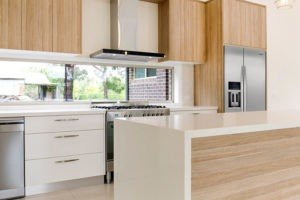 GT Kitchen with White Waterfall Island and Light Wood Contemporary Cabinets
