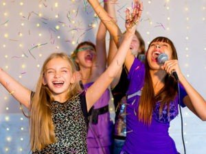 GT Teenagers singing with microphone and confetti