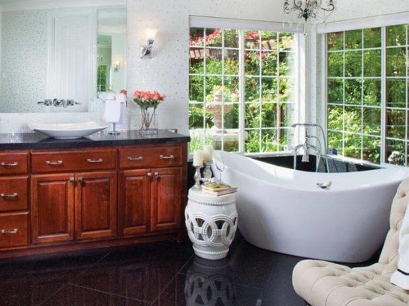 bathroom scene with tub and vanity